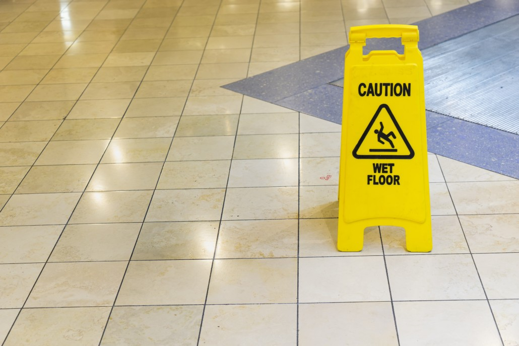 yellow wet sign on the floor